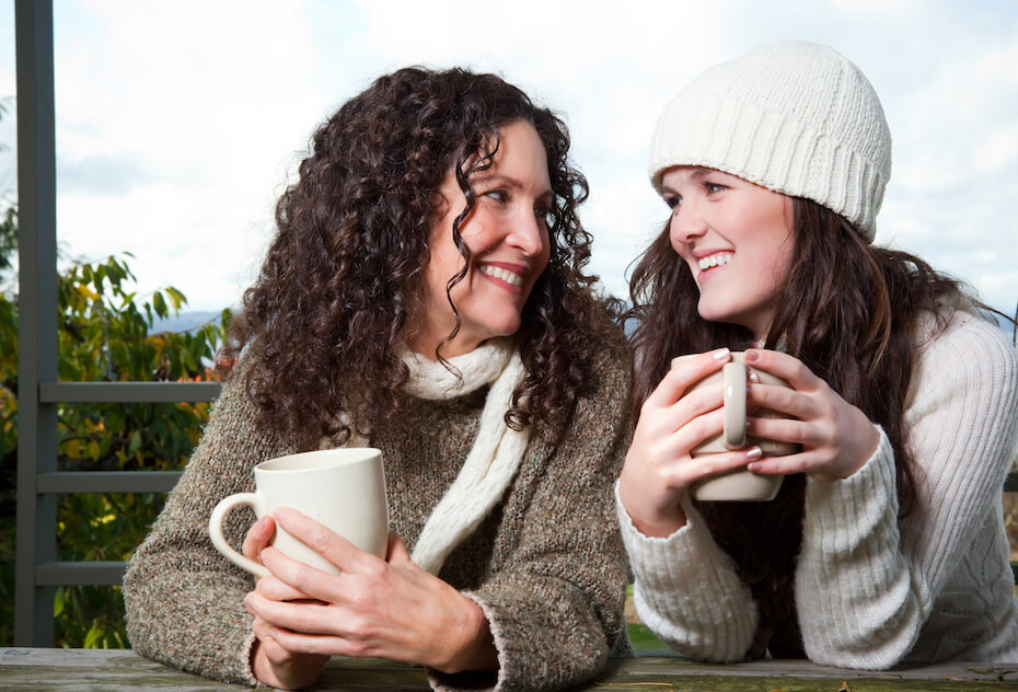 Shutterstock: Mom and daughter having coffee outside and talking
