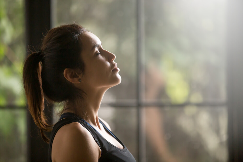 shutterstock-woman-breathing-deeply-near-window-meditation-040620