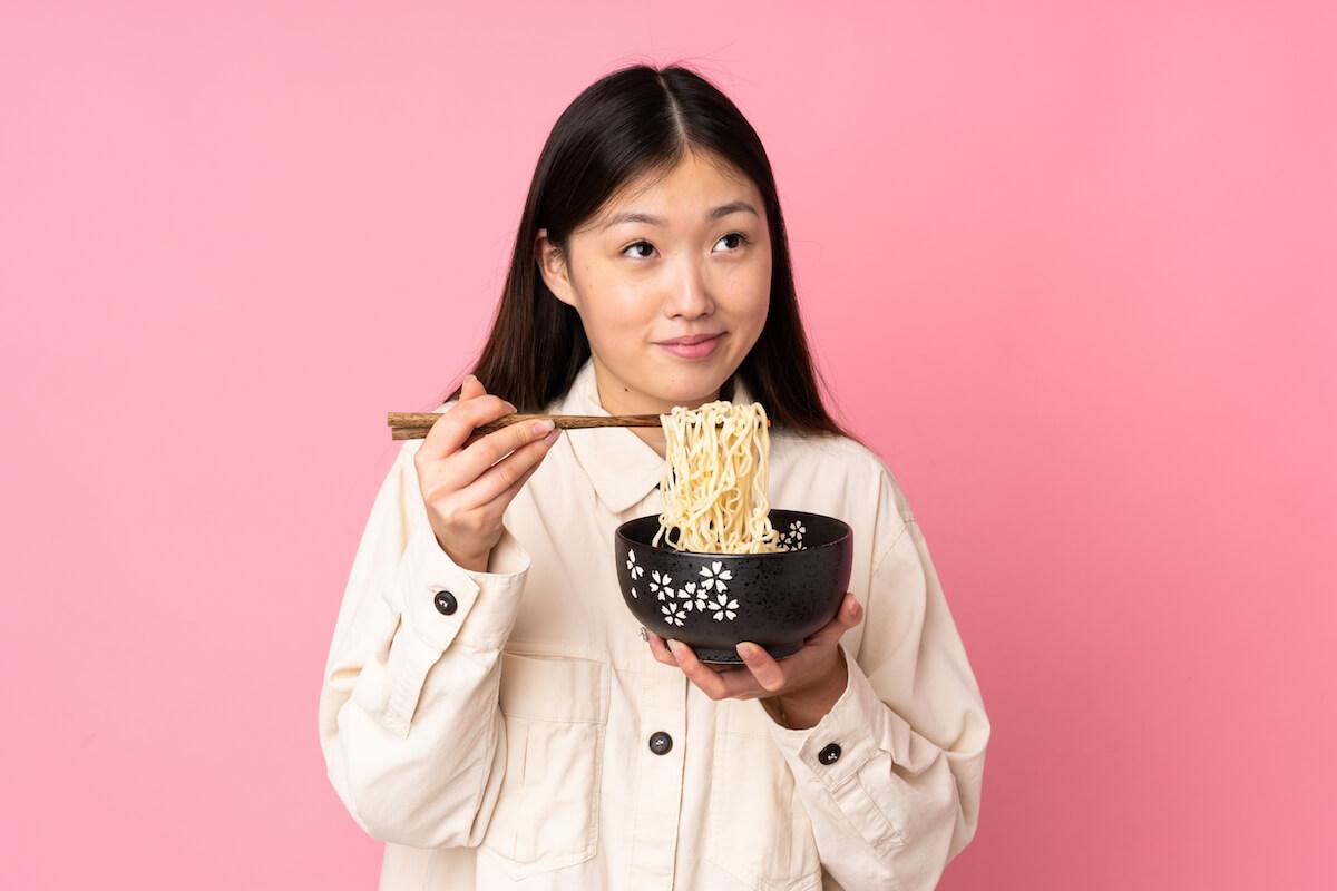 shutterstock-woman-eating-ramen-out-of-bowl