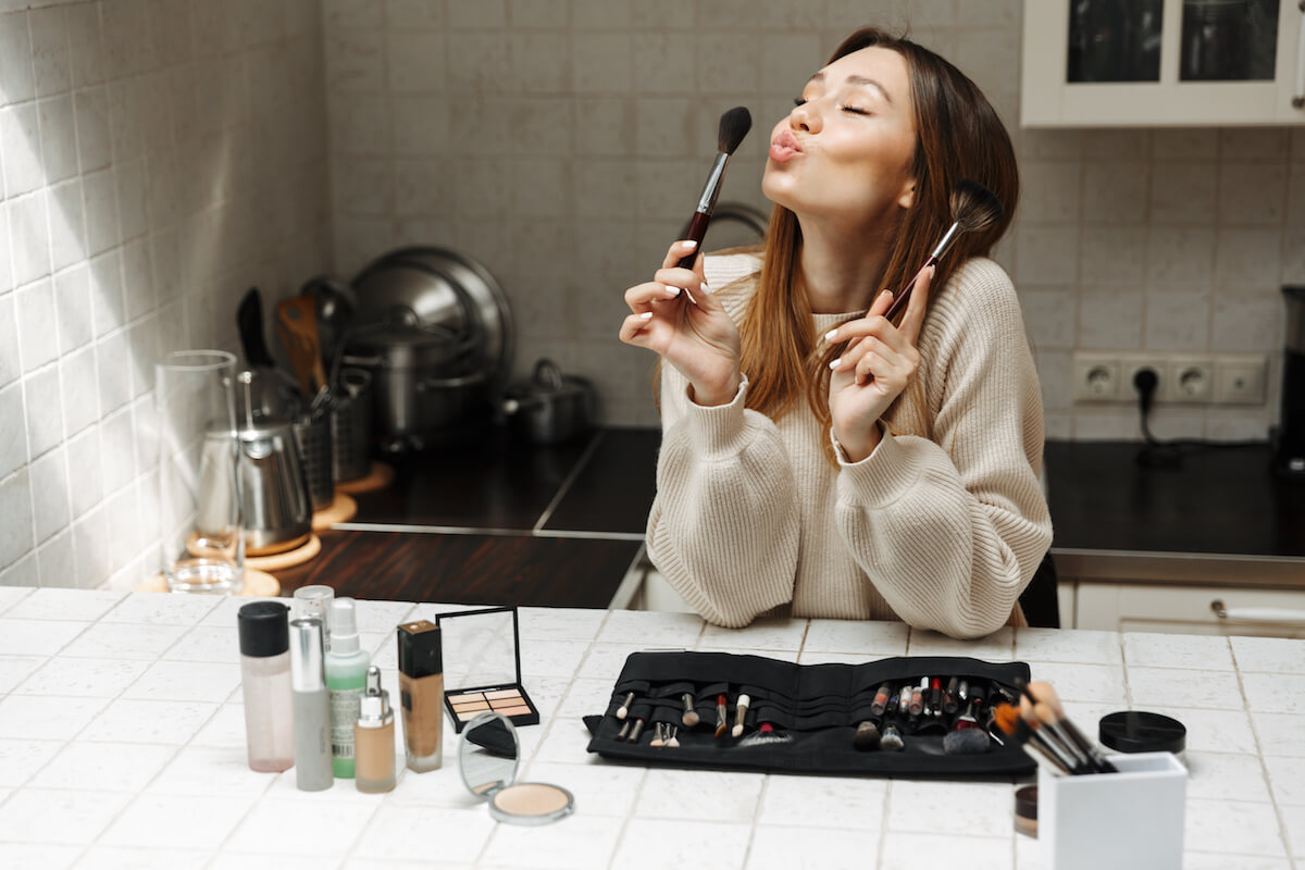 Shutterstock: Woman getting ready to do her makeup