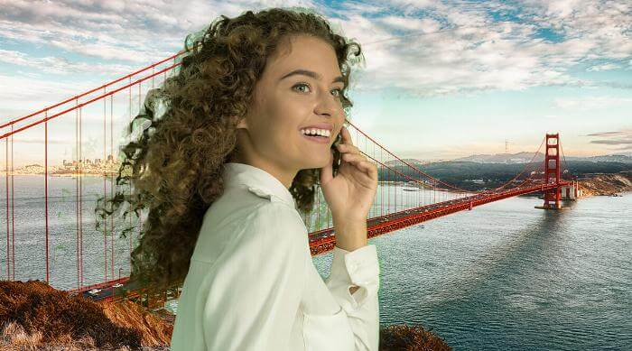 Shutterstock: Woman in front of green screen photo of San Francisco