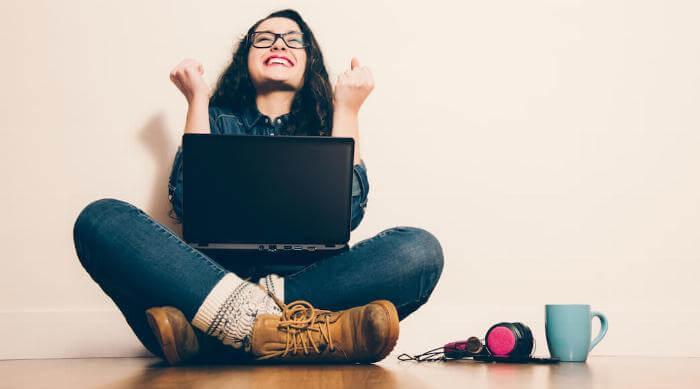 Shutterstock: Woman on laptop happy celebrating success
