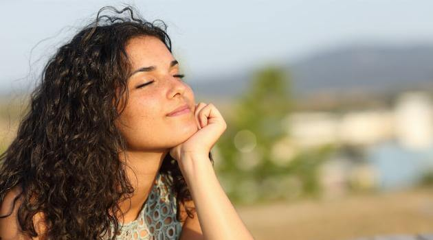 shutterstock-woman-smiling-contentedly-in-sun-alone-031920-articleH-042020