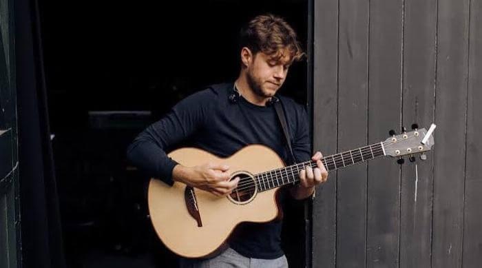 Instagram: Niall Horan playing acoustic guitar