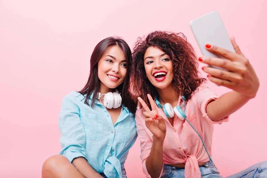 Shutterstock: Friends taking selfie together