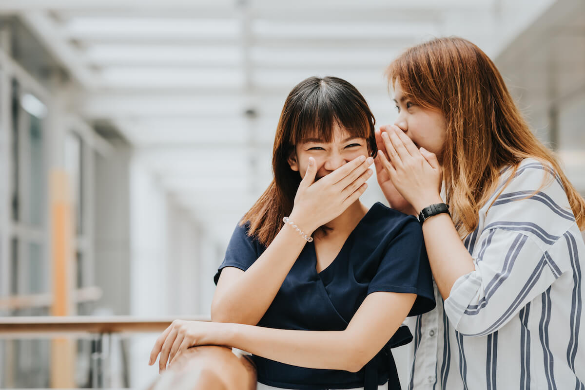 Shutterstock: Friends telling jokes secrets laughing together