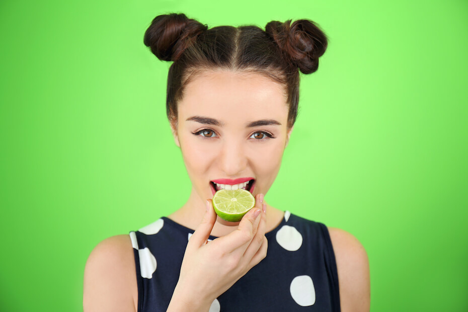 shutterstock-woman-biting-on-lime-051920