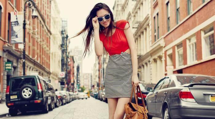 Shutterstock: Woman fashionable in center of street wearing sunglasses