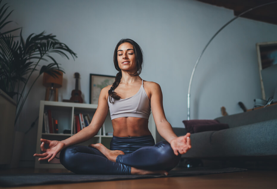 shutterstock-woman-meditating-in-living-room-052220