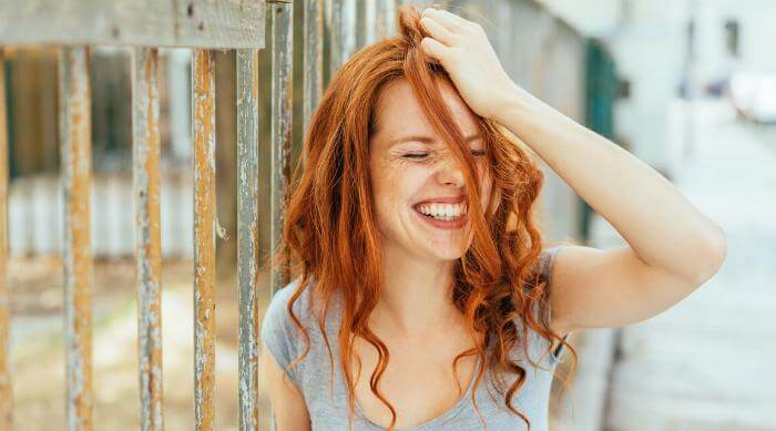 Shutterstock: Woman laughing embarrassed made a mistake oops