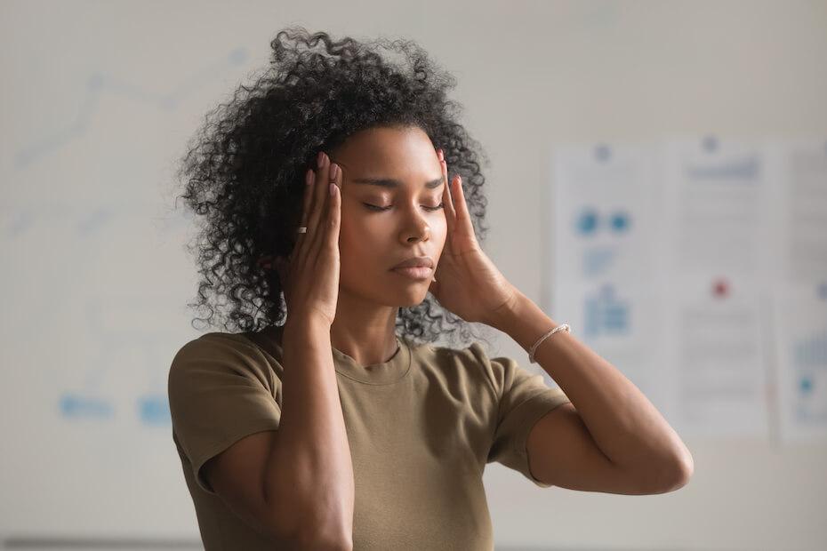Shutterstock: Woman overwhelmed stress too much