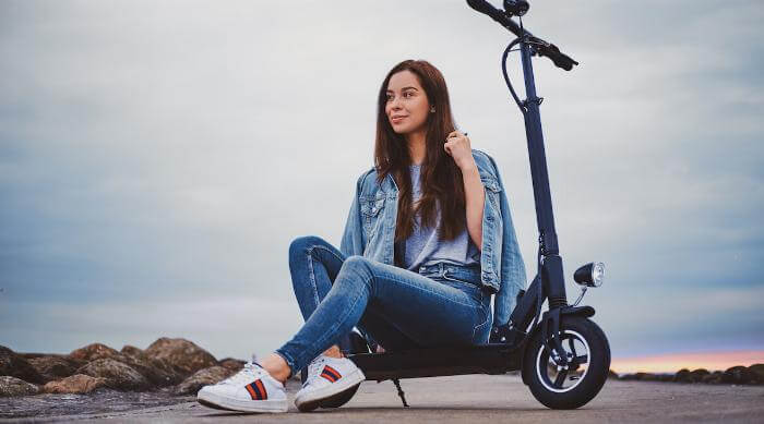 Shutterstock: Woman sitting on scooter on cloudy day