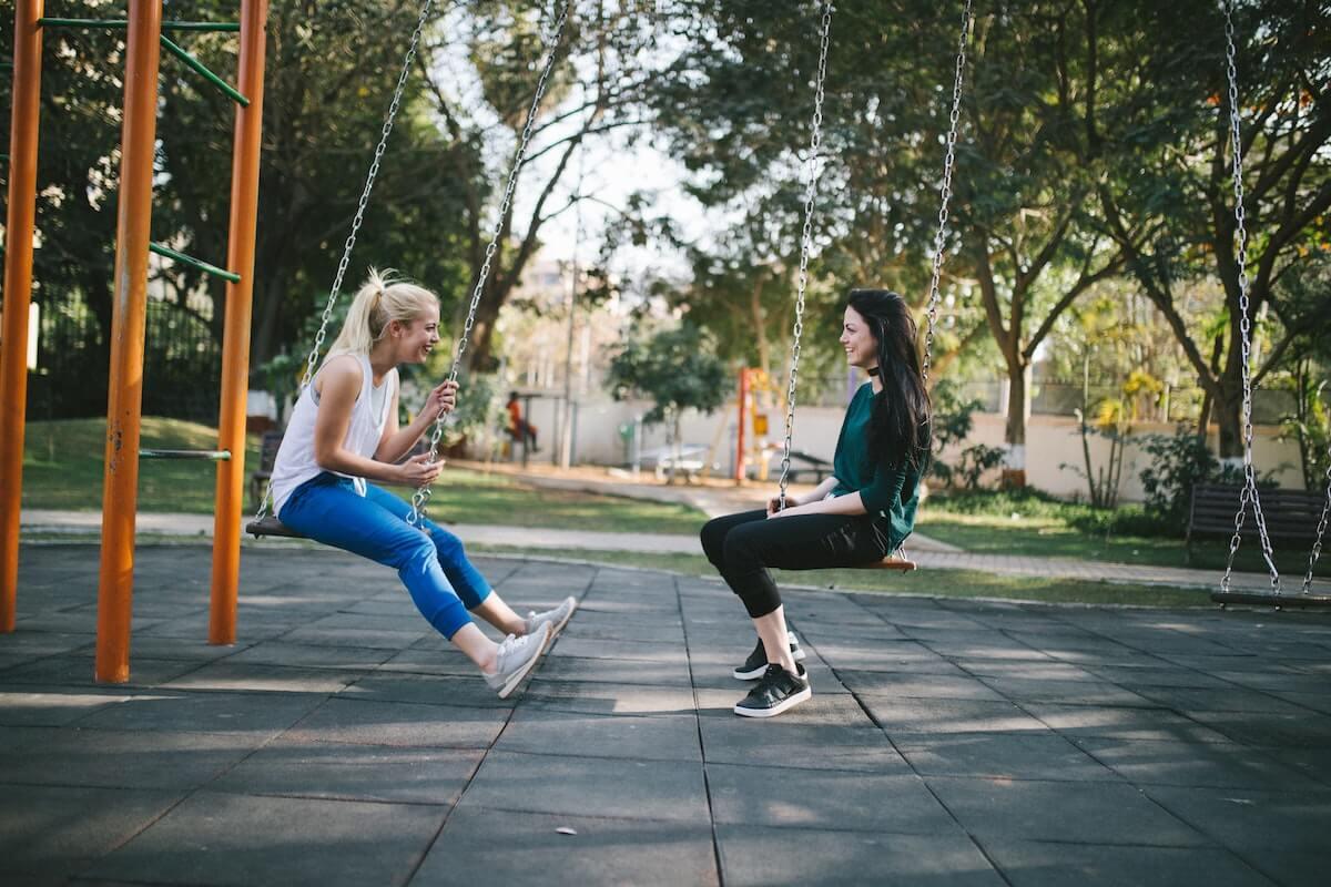 Friends Sitting on Swings