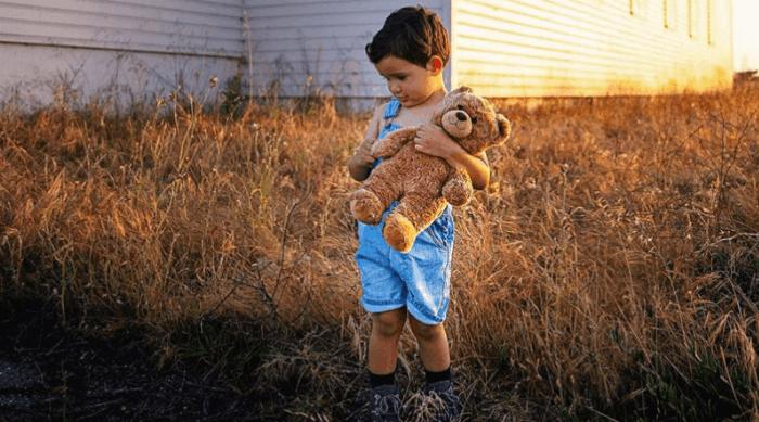 boy holding stuffed animal