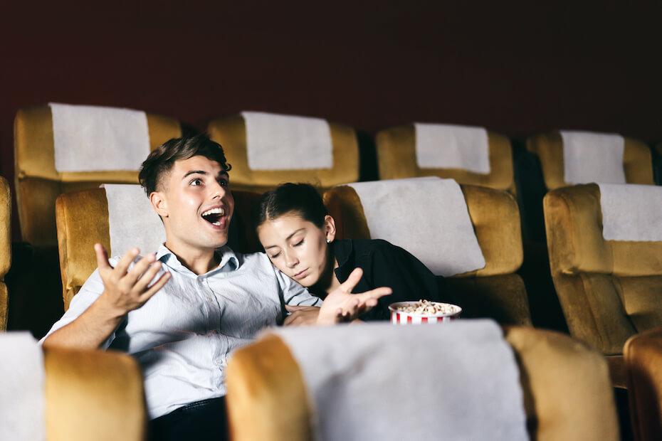 shutterstock-couple-at-movie-theater-guy-talking-girl-sleeping-061620
