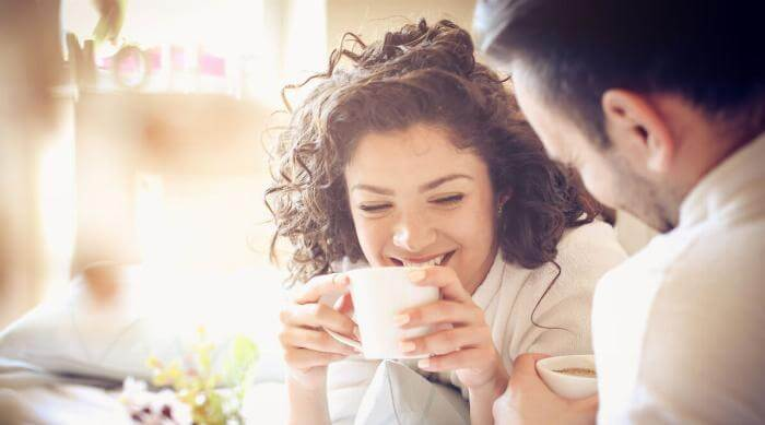 Shutterstock: Couple mad and woman having conversation and drinking coffee looking happy