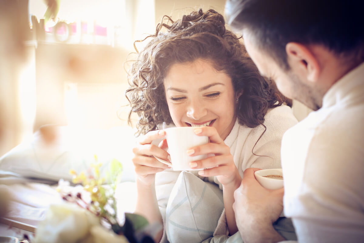 shutterstock-couple-man-and-woman-conversation-having-coffee-happy