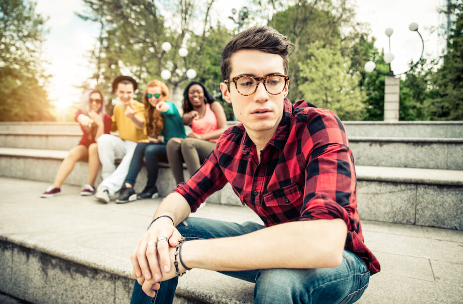 shutterstock-group-of-friends-pointing-laughing-bullying-boy-063020