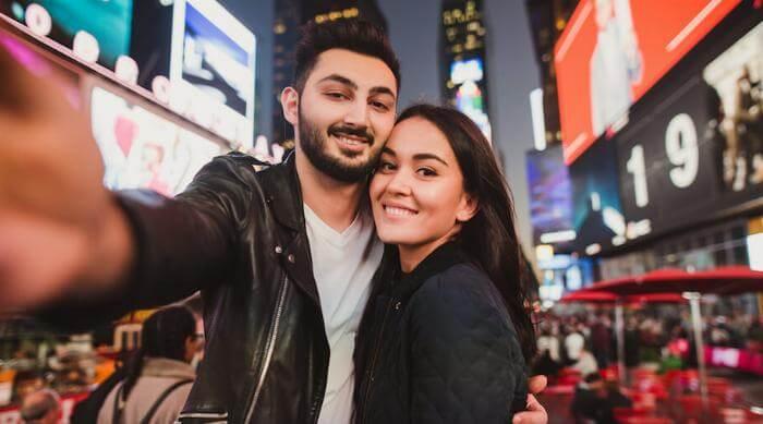 Shutterstock: Smiling couple posing for selfie