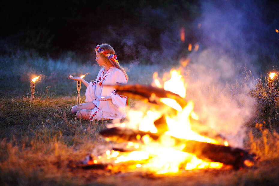 shutterstock-woman-in-flower-wreathe-near-bonfire-063020