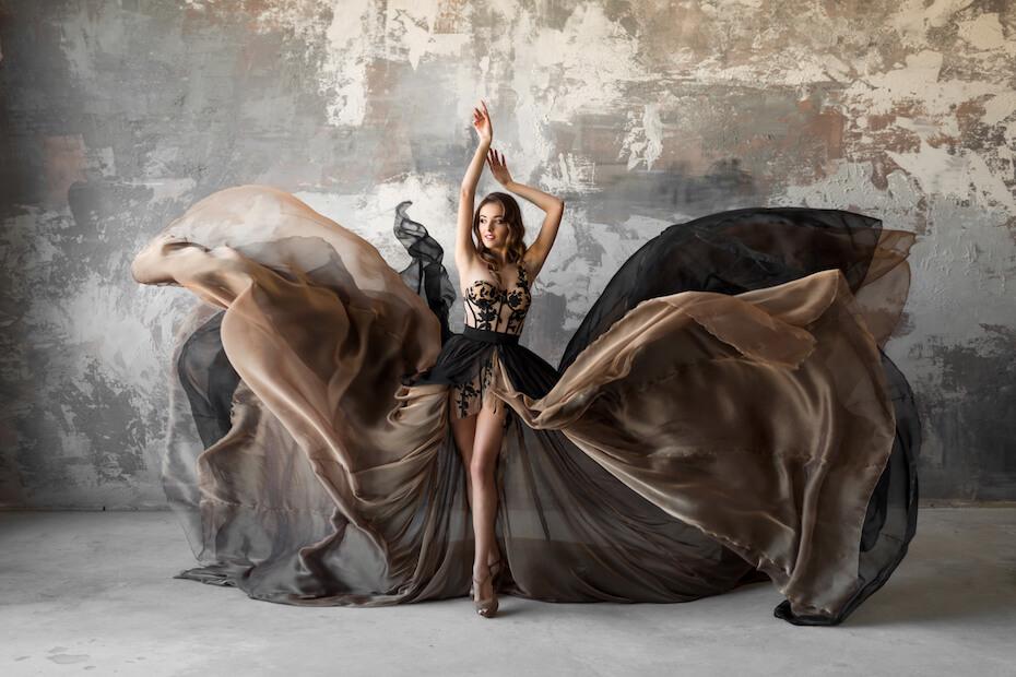 Shutterstock: Woman in grey brown flowing dress