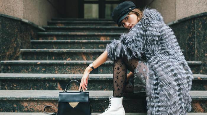 Shutterstock: Woman posing in grey furry coat