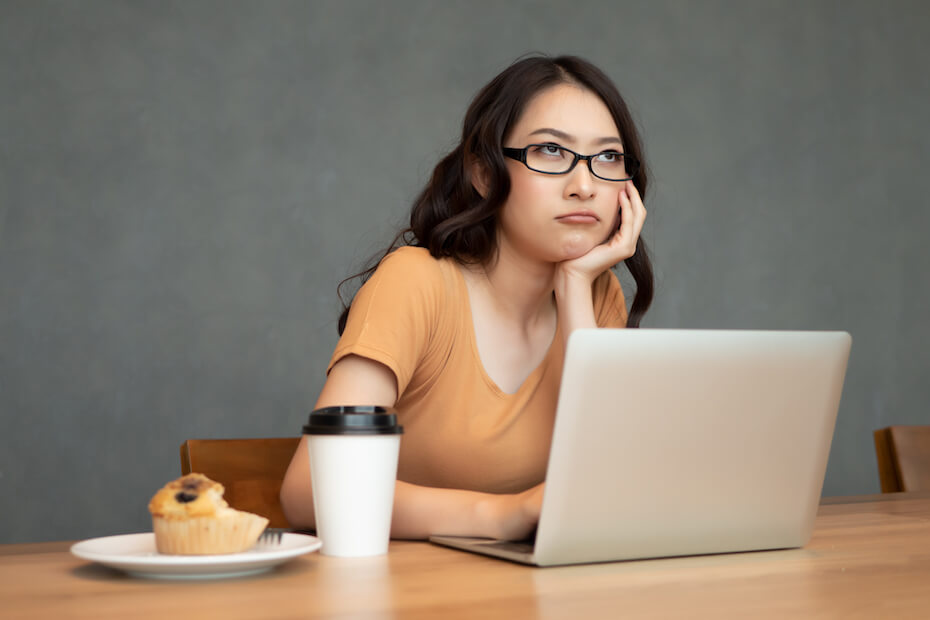 Shutterstock: Woman looking bored and annoyed on computer