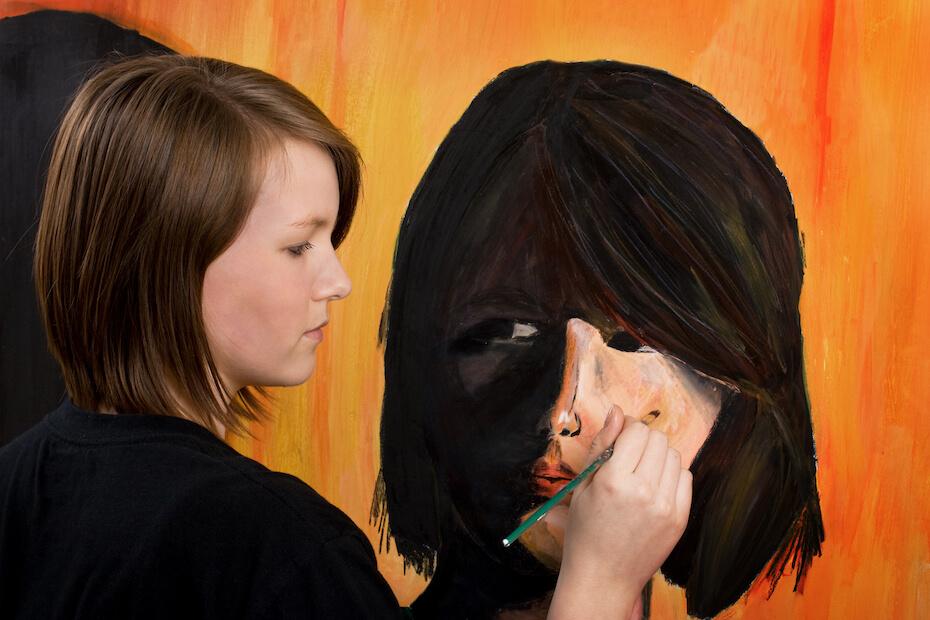 shutterstock-woman-painting-self-portrait-on-canvas-061520