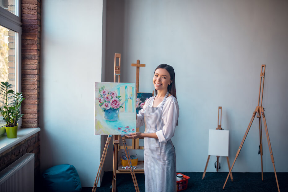 shutterstock-woman-proudly-smiling-with-flower-painting-061520
