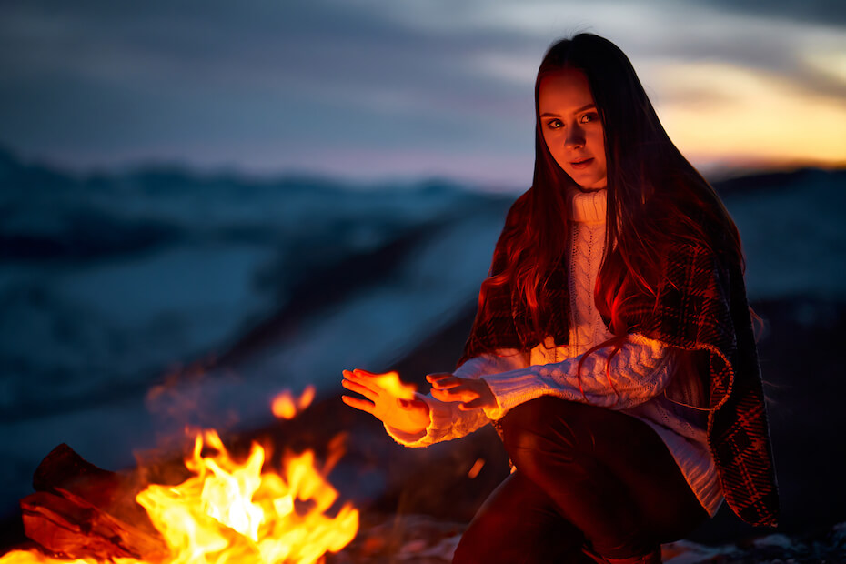 shutterstock-woman-warming-hands-by-the-fire-063020