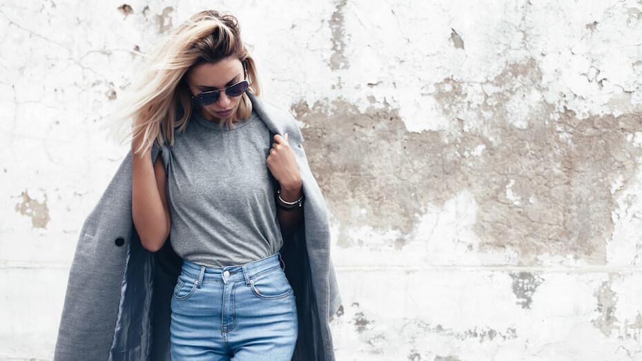 Shutterstock: Woman wearing grey T-shirt and coat