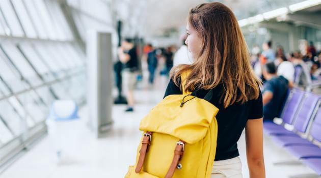 shutterstock-woman-with-backpack-in-airport-051220-articleH-062620