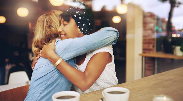 shutterstock-friends-meeting-coffee-smiling-hugging-articleH-071520