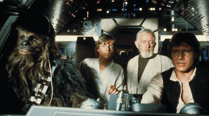 Star Wars: A New Hope movie still with Chewbacca, Luke Skywalker, Obi-Wan Kenobi and Han Solo in the Millenium Falcon