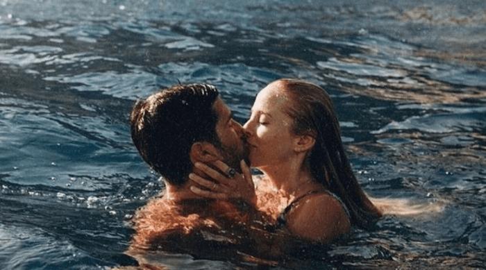 couple kissing in ocean