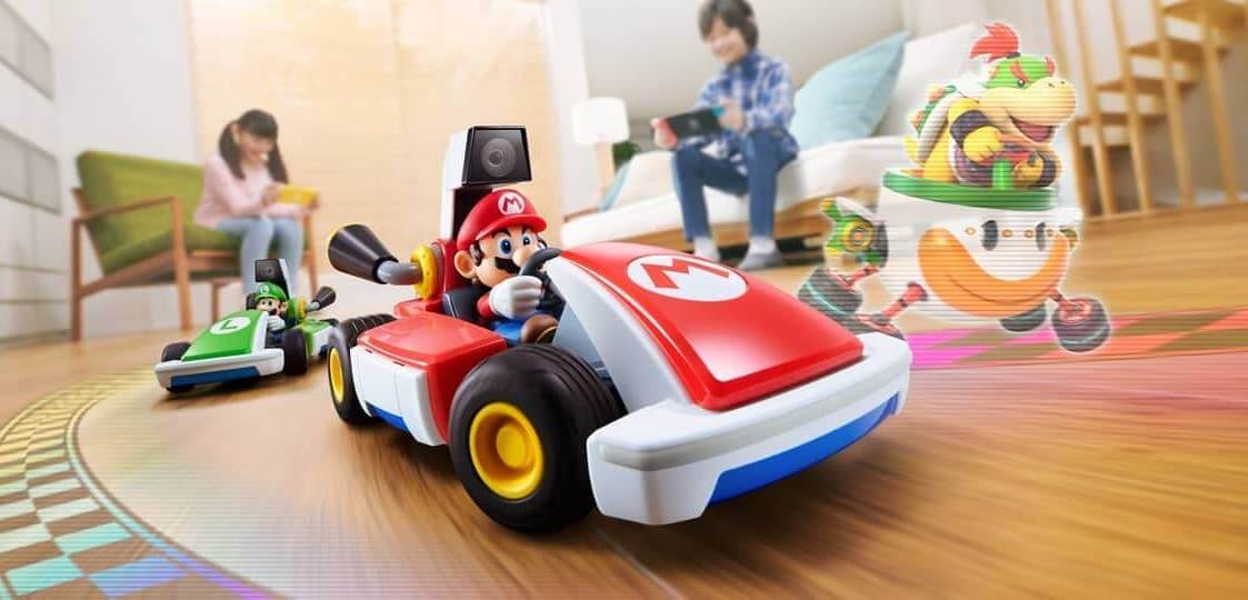 Mario Kart Live: Home Circuit family playing with karts