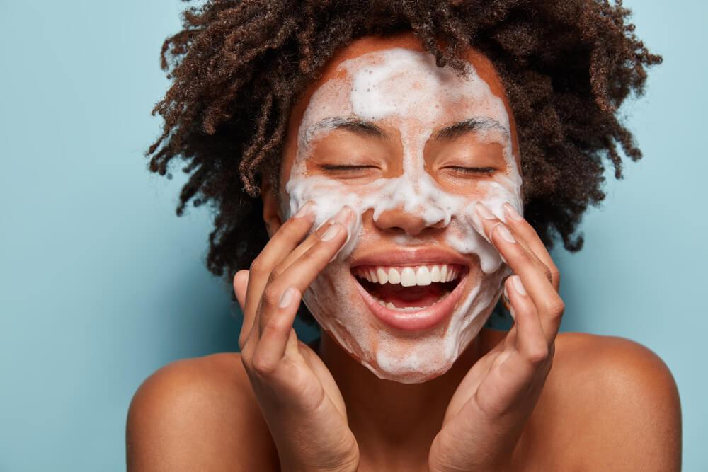 Shuttestock: Woman doing skincare routine