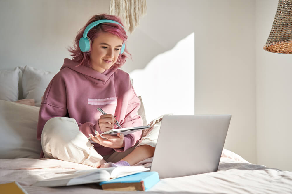 girl studying bed