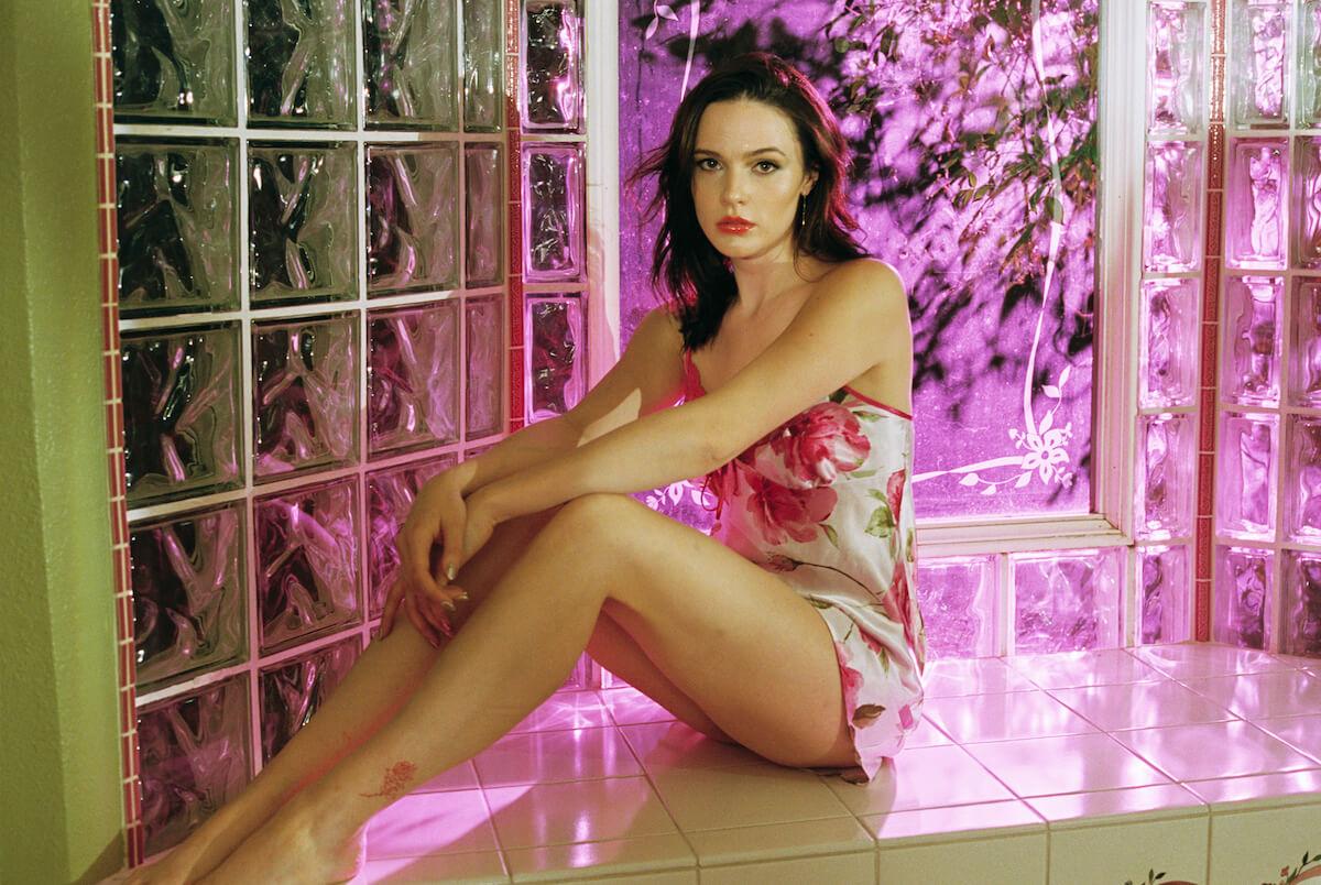 Elizabeth Miranda: Ginesse sitting against tiles
