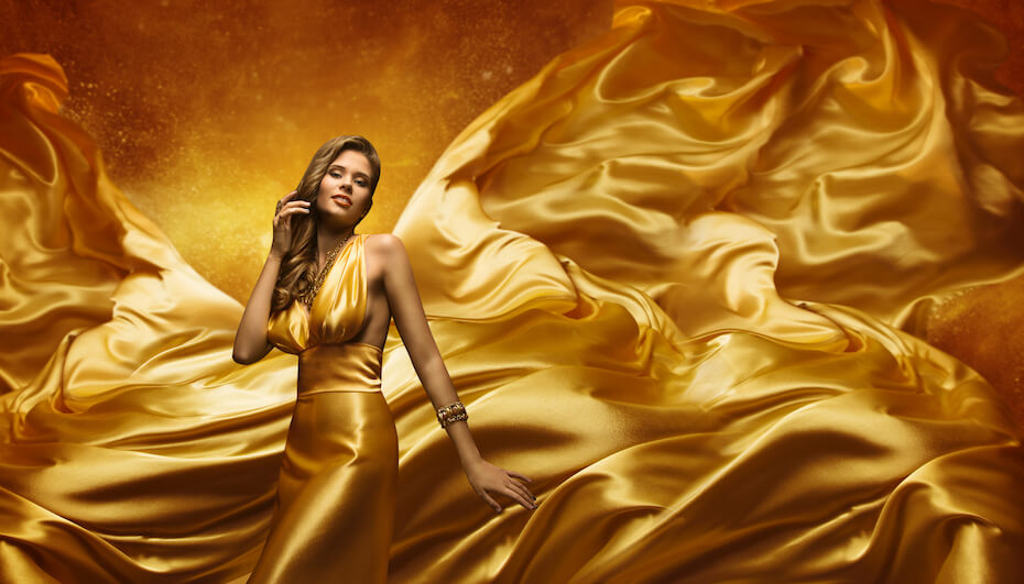 Shutterstock: Woman with gold flowing dress