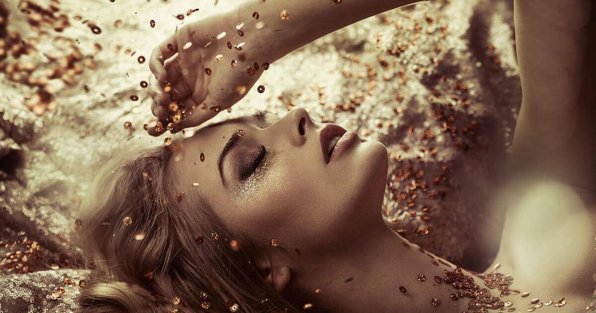 Shutterstock: Woman with gold sparkles and glitter