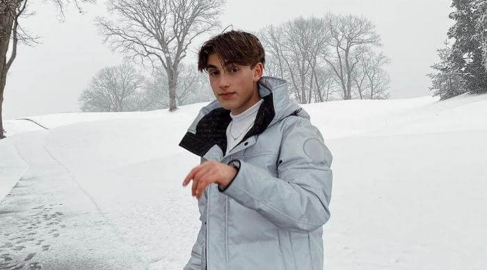 Instagram @johnnyorlando snowy white coat