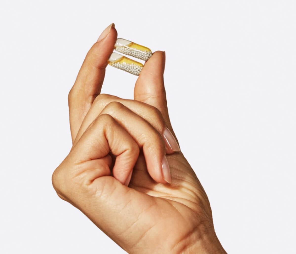 hand holding vitamins