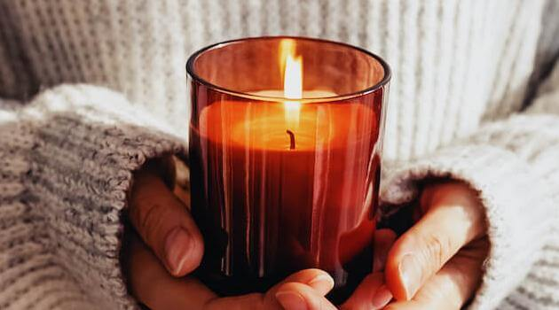 Shutterstock: woman holding candle