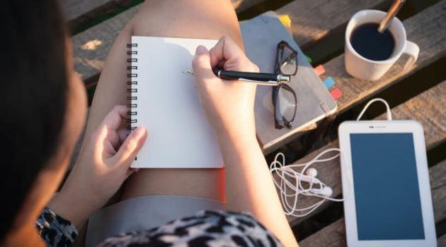 Shutterstock: woman journaling with tablet and coffee