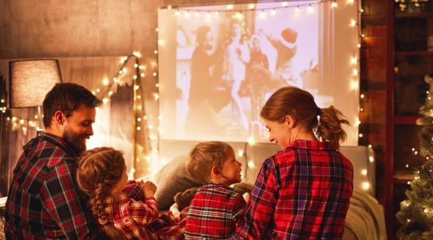 Shutterstock: family watching Christmas movie
