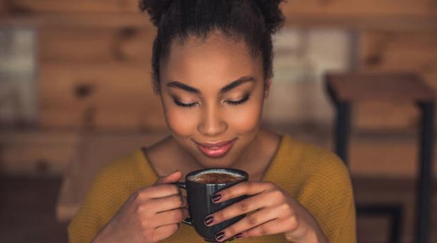 Shutterstock: woman drinking coffee