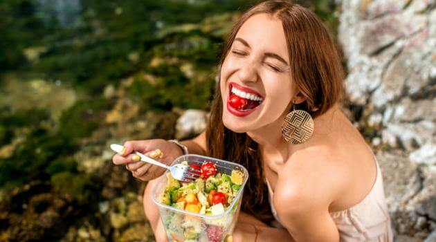 Shutterstock: woman eating salad