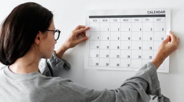 Shutterstock: woman looking at calendar