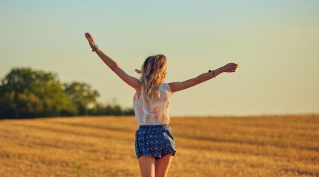 Shutterstock: woman running in a field of wheat
